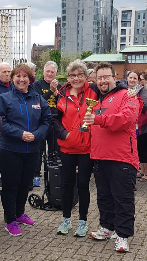 Worcester Dragons' Marie Jennings and Jason Haines collect the first place trophy in Liverpool from Jenni Henderson. Picture: MANDA HANDS
