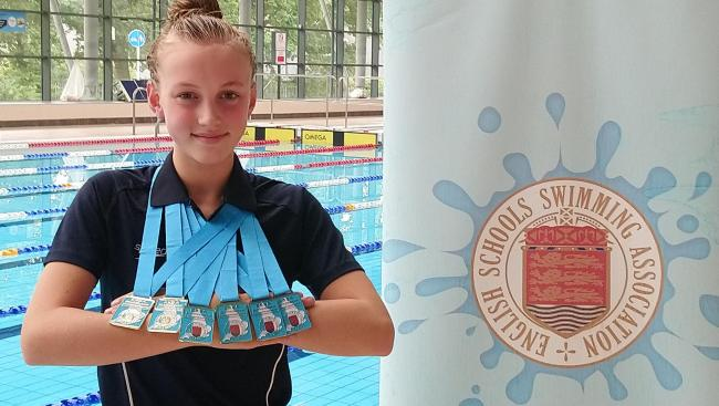 Aimee Monks shows off her England Schools Swimming Association's Summer Open Individual Championships medals. Picture: NEIL MONKS