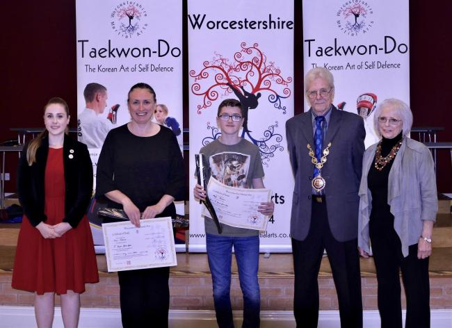 New black belts Lisa Perkins and Mylo Thomas with Droitwich Spa mayor William Moy and his wife Dilys and Worcestershire Martial Arts founder Sally Gleaves