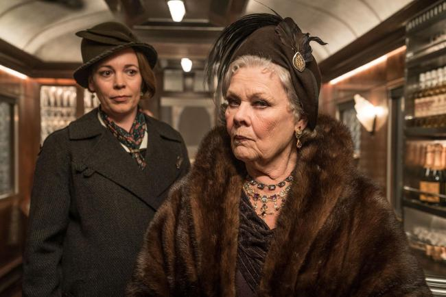 Undated film still handout from Murder On The Orient Express. Pictured: Olivia Colman as Hildegarde Schmidt and Dame Judi Dench as Princess Dragomiroff. See PA Feature SHOWBIZ Download Reviews. Picture credit should read: PA Photo/Twentieth Century Fox Fi