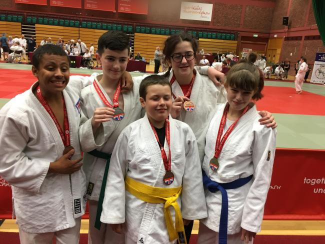 Kazoku-Kan Judo Club's British Open Championships medallists, back row (left to right): Liam Jones, Joshua Warburton and Felicity Warburton. Front: Corey Chapman and Sophie Kenny. Picture: KATHRYN WARBURTON