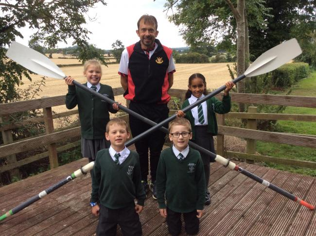Children from Hanbury First School with headteacher Mr Payne before he left to join his Worcester Rowing Club colleagues in Hungary.