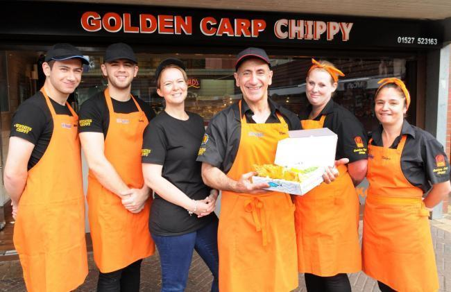 BEST IN TOWN: Theo Ellinas (centre) from the Golden Carp Chippy last year.