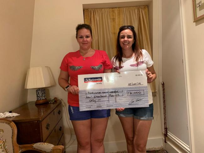 The sisters raised £4,000 in memory of their mother.