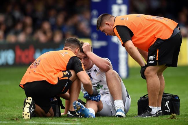 Nick Schonert is treated by medics at Bath. Picture: Patrick Khachfe/JMP