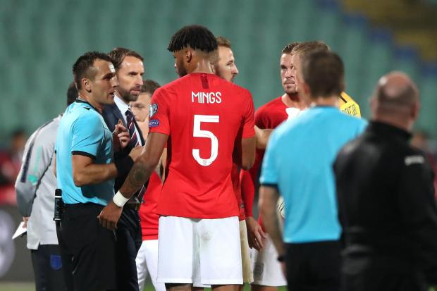 STOPPAGE: Match referee Ivan Bebek speaks to England manager Gareth Southgate and Tyrone Mings. PA
