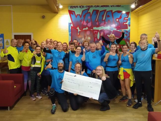 The Evesham Town 10k organisers hand over cheque to Wallace House Community Centre