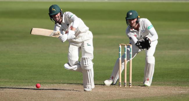 Nottinghamshire batsman Jake Libby scores runs watched by Worcestershire wicketkeeper Ben Cox during the Specsavers County Championship match at Trent Bridge, Nottingham.