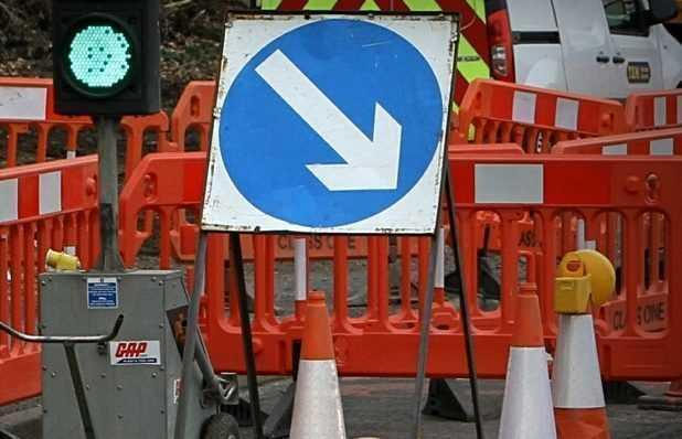 SIGN: Road works traffic directional arrow