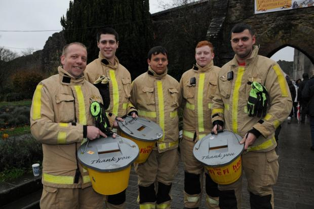 Ludlow Firefighters Crew Manager Mark Nicholas and Firefighters Sam ward, Cameron Harrison and Sam Nicholas with Crew Manager Olie Powis who spent a day at the Ludlow Christmas Medieval Fayre collecting money for the Firefighters Charity.