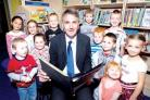 CHAPTER ONE: Worcester MP Mike Foster in the library at Dines Green Primary School.