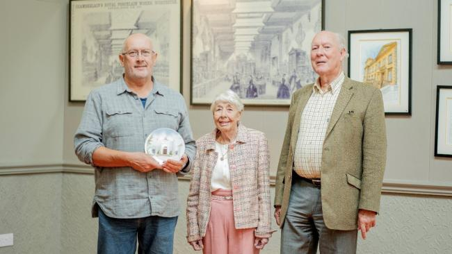 PORCELAIN: Tony Young (left) with Brenda and Colin Kinnear, trustees of the Bransford Trust in the Henry Sandon Hall