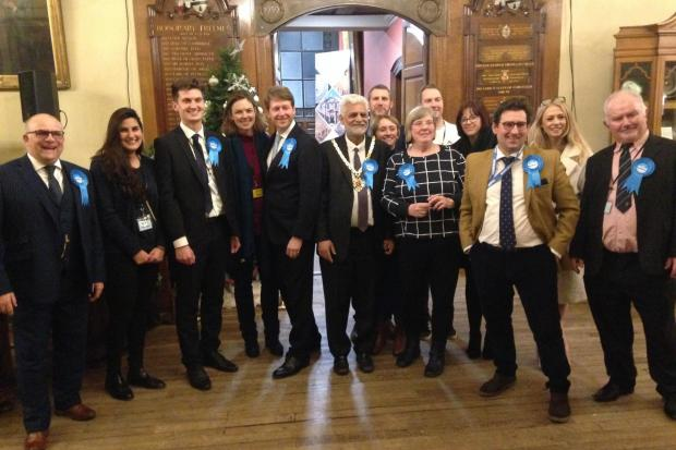 VICTORY: Robin Walker celebrates his election victory in the Guildhall with his fellow Conservatives