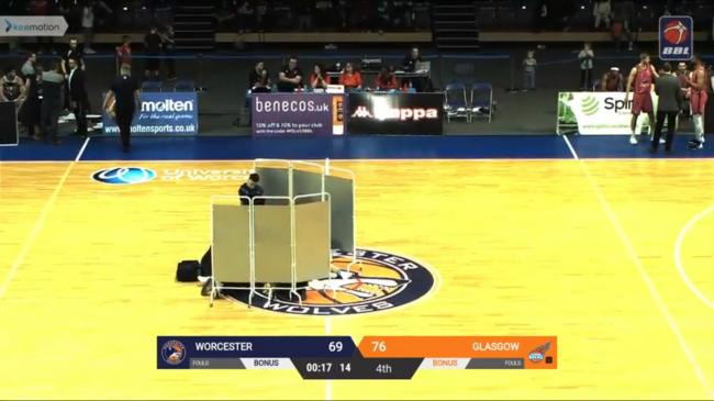 The injured cheerleader is treated on the court in Worcester. Picture: youtube.com British Basketball League channel