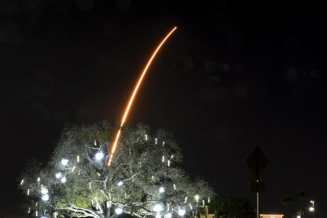 In a time exposure, the SpaceX Falcon 9 rocket launches from Cape Canaveral, Florida