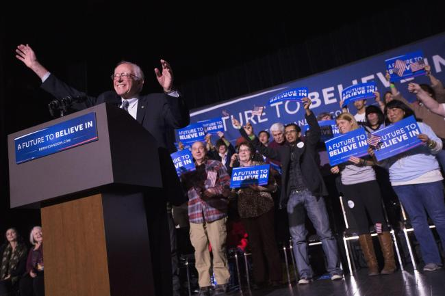 Democratic presidential candidate, Sen. Bernie Sanders, I-Vt. waves to the crowd during a campaign stop at The Colonial Theatre, Tuesday, Feb. 2, 2016, in Keene, N.H. (AP Photo/John Minchillo).