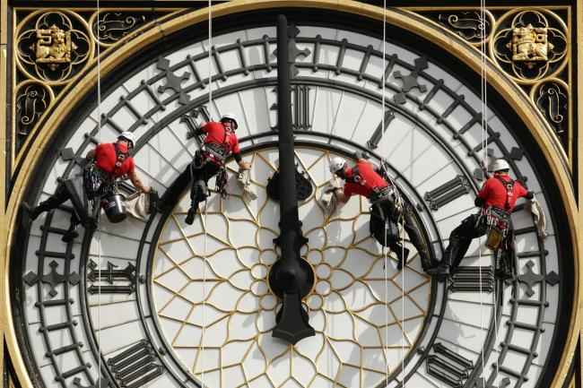 A specialist team clean one of Big Ben's clock faces