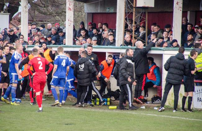 UGLY SCENES: City's match at Atherstone was stopped many times due to abuse from and objects being thrown by fans. Pic: Roger King.