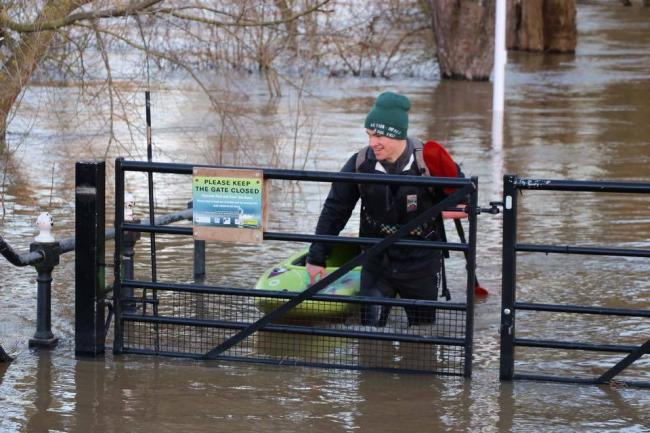 FLOAT: Some people are making the most of the floods (credit: Russell Hall)