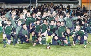 UP FOR THE CUP: RGS Worcester's players celebrate after winning the Modus Challenge Cup at Sixways.