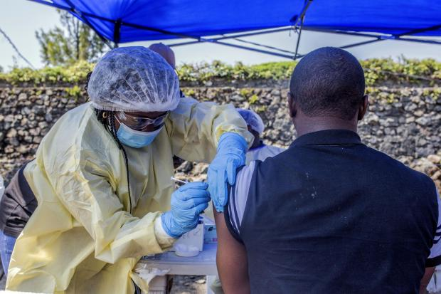 A man receives a vaccine against Ebola from a nurse outside the Afia Himbi Health Center on July 15, 2019 in Goma. - Authorities in Democratic Republic of Congo have appealed for calm after a preacher fell ill with Ebola in the eastern city of Goma, the f