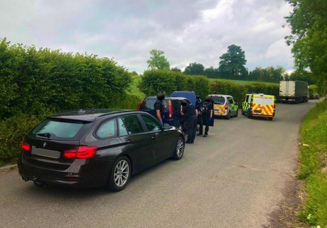 ARREST: The car being searched. Pic. @LpptSWestMercia on Twitter
