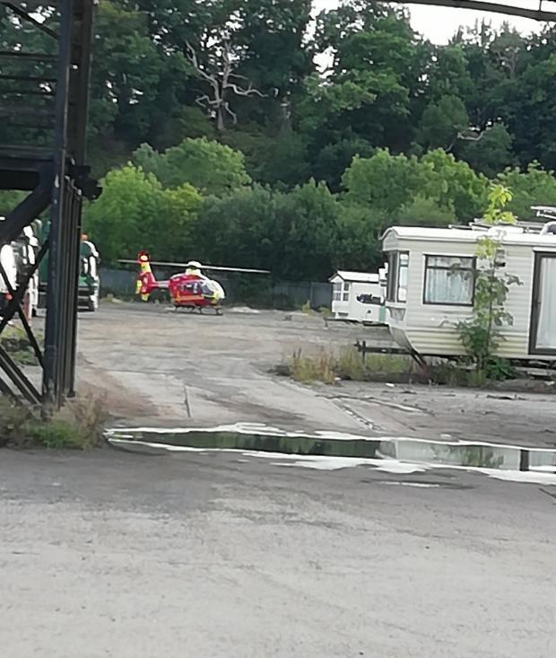 EXPLOSION: An air ambulance at the scene of the explosion