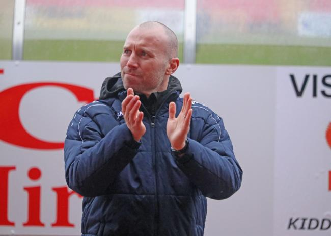 Manager Russ Penn applauds Harriers fans