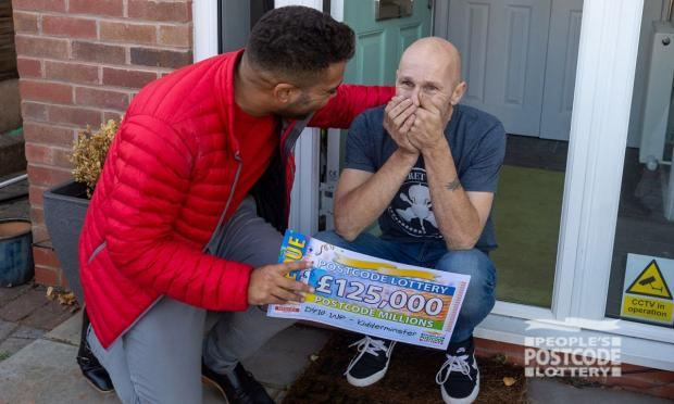 Worcester News: Mark fell to the floor in shock (Photo: People's Postcode Lottery)