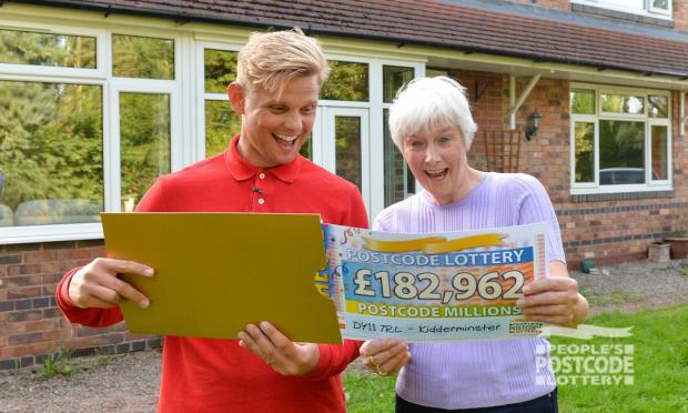 Worcester News: Joan with her cheque (Photo: People's Postcode Lottery)