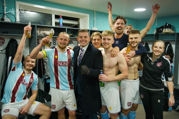Players celebrate with chairman Chris Pinder. Pic: Cliff Williams/Malvern Town FC
