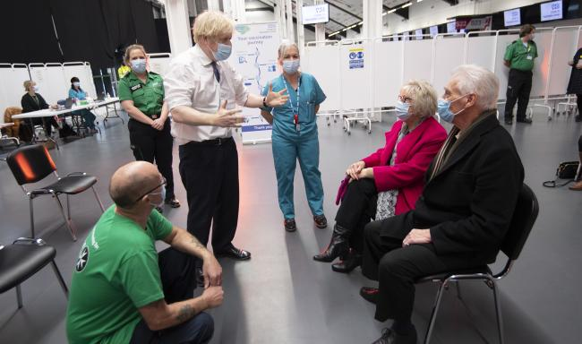 Prime Minister Boris Johnson talks to Hazel and John Watson at Ashton Gate Stadium in Bristol during a visit to one of the seven mass vaccination centres now opened to the general public