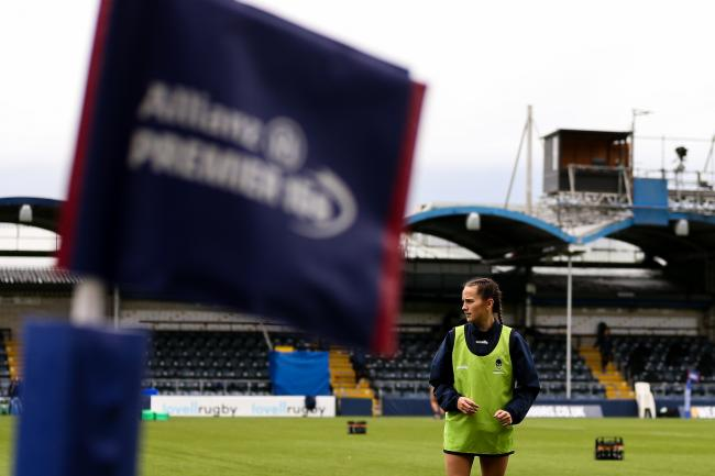 'Caity Mattinson of Worcester Warriors Women warms up in front of the Allianz Premier 15's flag - Mandatory by-line: Nick Browning/JMP - 24/10/2020 - RUGBY - Sixways Stadium - Worcester, England - Worcester Warriors Women v Wasps FC Ladies - A