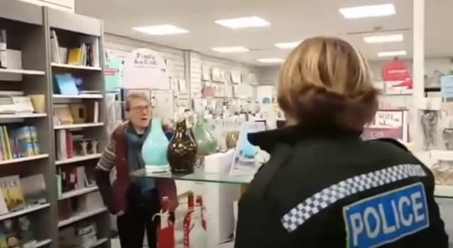 SHOP: Police speak to owners of Grace Cards and Books. Picture: 'THEGREATREOPENING'/Youtube