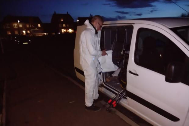 A forensics officer outside the house in Vashon Drive, Copcut, Droitwich