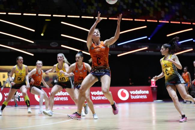 Severn Stars' Lucy Harris (in orange kit, centre of photo) setting up a Stars attack. Pic: Morgan Harlow