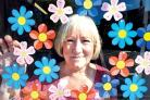 FLOWER POWER: Susan Page, deputy manager of the Daisychain Benevolent Fund shop in St John's.