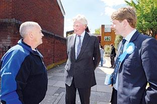 CHAT: From left, Kelvin Smith talks to Lord Heseltine and Tory candidate Robin Walker as the Conservatives canvass in Blackpole and Warndon.