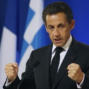 French President Nicolas Sarkozy is to host new Prime Minister David Cameron (AP)