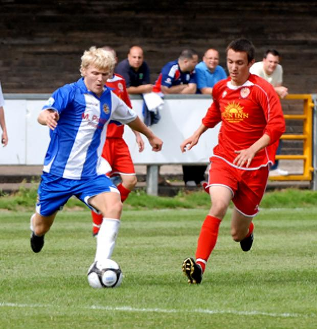 City's Tom Thorley takes on an AFC Liverppol defender. 30054118.