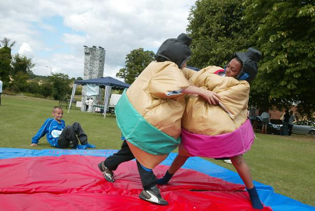 Example of two people enjoying sumo suit wrestling