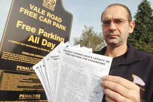 Neil Harman at the Vale Road car park in Stourport with the petition, which has been signed by more than 600 people. Mr Harman has vowed to keep fighting for free parking on the site.