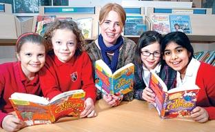 Worcester News: Author Sorrel Anderson pictured with pupils Charlotte Broadhurst, left, Oscar Binding,  Grace Moseley and Ismah Qayum, all aged eight. 11229002.