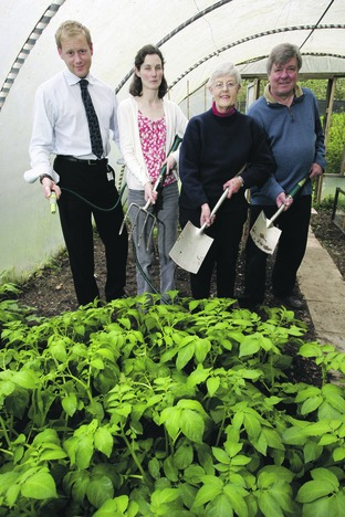 FIVE A DAY: Peter Mackenzie-Shaw, funding manager from Worcestershire County Council, Trudy Pavitt, from Age Concern, Christine Jackson, garden owner, and gardener Roger Walter celebrate the scheme's new funding boost.