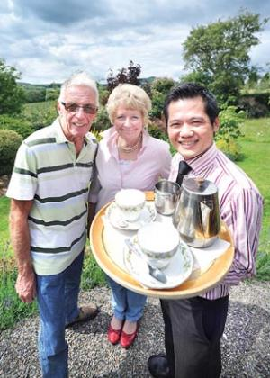TEA-TIME: From left, Alan Green,  open garden organiser; Pam Thompson, of Pear Tree Cottage; and Davy Ling, of the Four Seasons restaurant. 25300906.