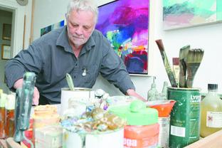 INSPIRED: Artist David Prentice hard at work in his studio. His paintings celebrate his love for the Malvern Hills.