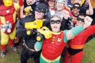 WINNERS: Barry Adams and Ro Mottram, as Batman and Robin, with fellow superheroes.