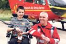 Joshua Dudley with Ian Roberts, who saved him after a road accident