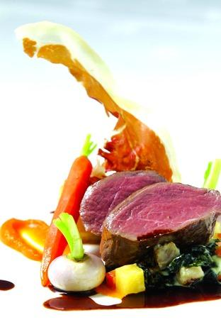 Roasted loin of Venison with creamed vegetables and chocolate