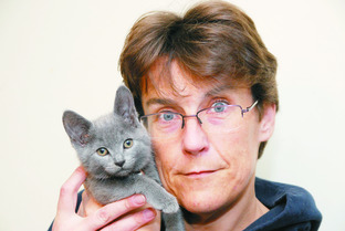 Heidi Barlow with Lola, one of her healthy cats.